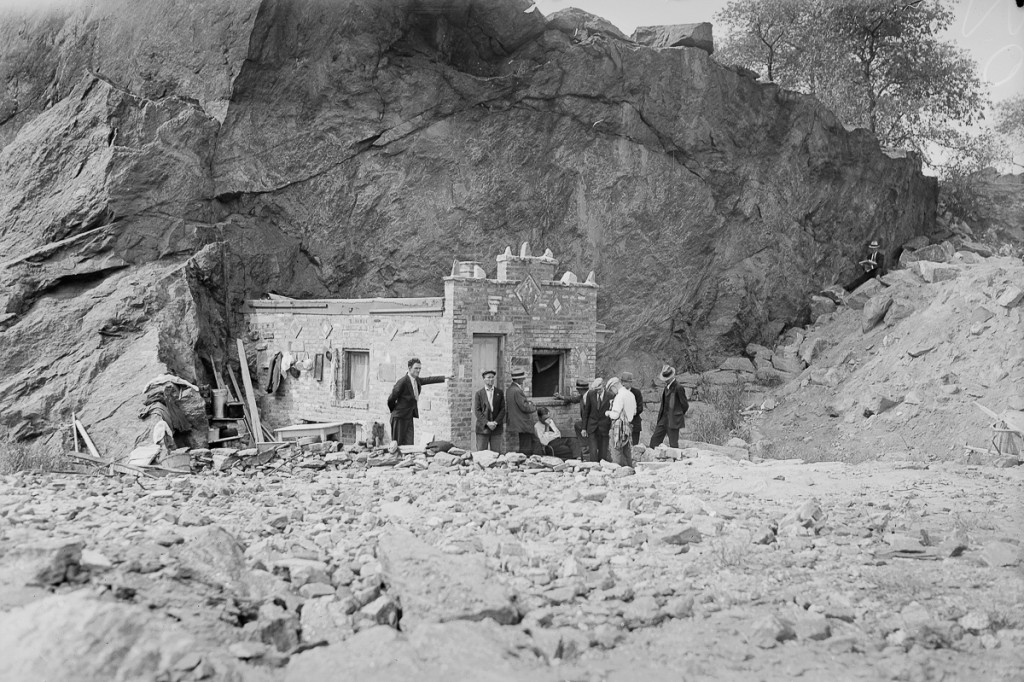 UNITED STATES - SEPTEMBER 22: Inhabitants of Hooverville gather outside the Mansion, town's chief edifice, which snuggles in lee of rocky cliff to protect it from wintry winds. (Photo by NY Daily News Archive via Getty Images)