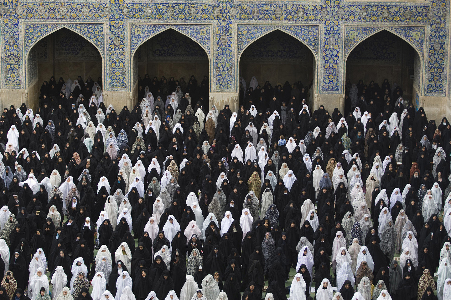Iranian women perform their Friday prayer at the Imam mosque