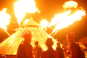 Participants watch the flames of the mutant vehicle as approximately 70,000 people from all over the world gather for the 30th annual Burning Man arts and music festival in the Black Rock Desert of Nevada, U.S.